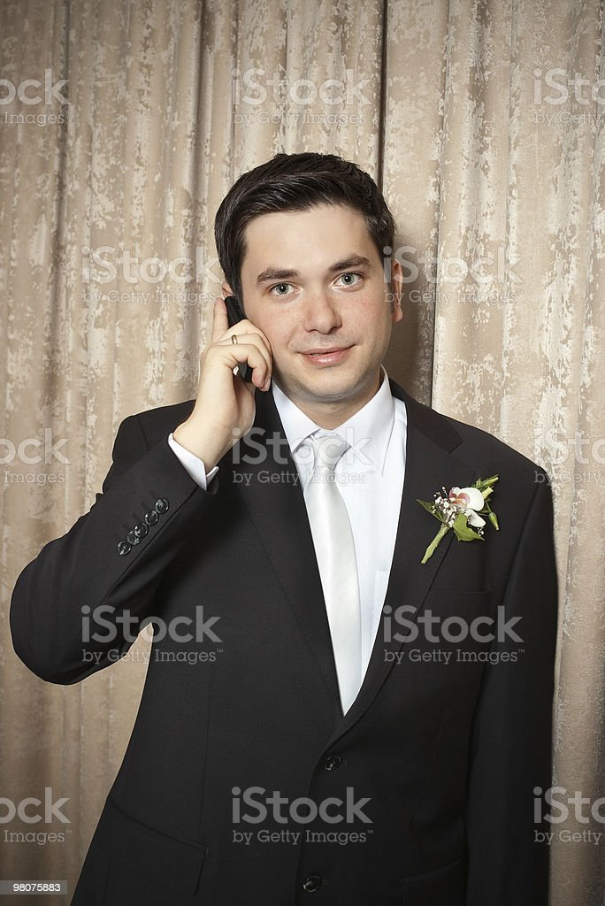 groom with mobile phone royalty-free stock photo