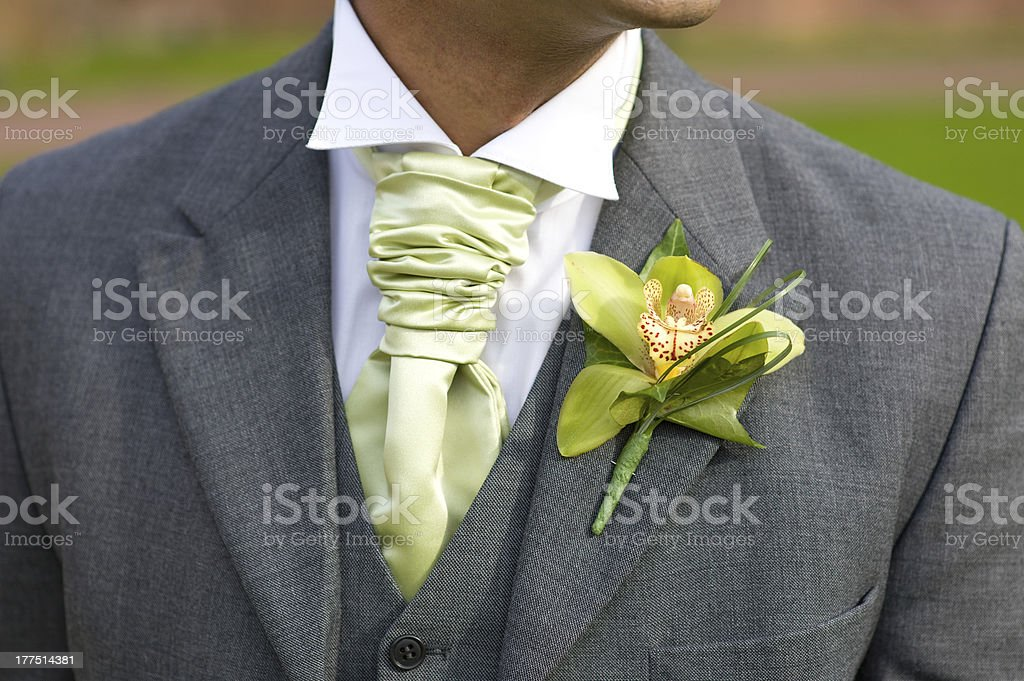 groom with orchid buttonhole at wedding royalty-free stock photo