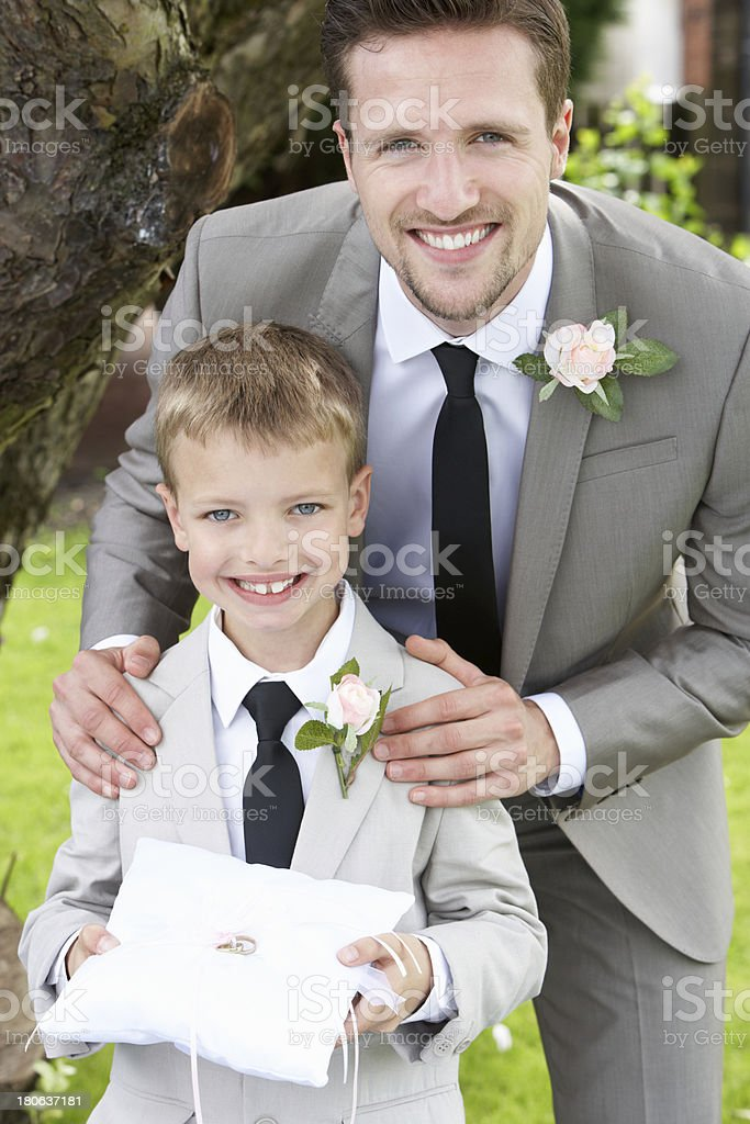 Groom With Page Boy At Wedding stock photo