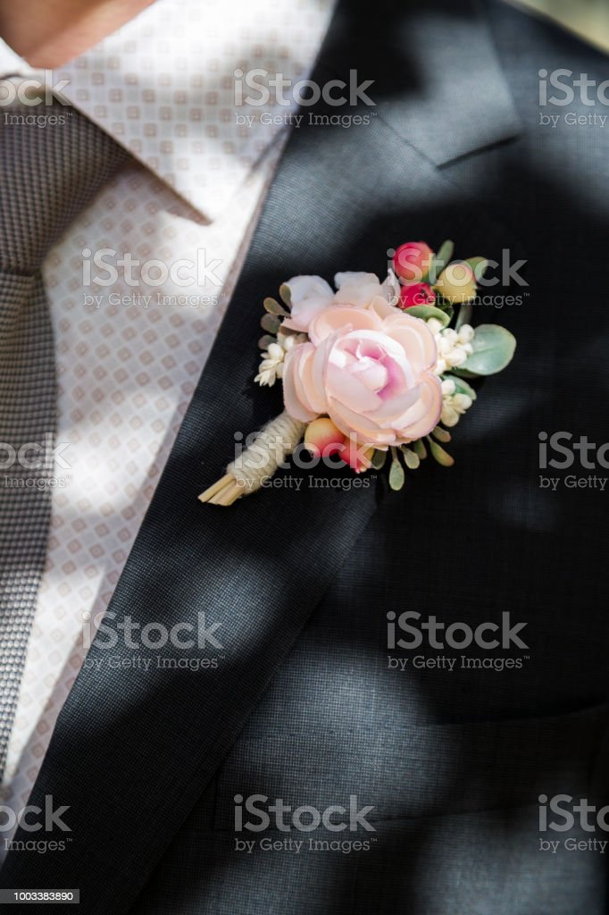 Groom with rose boutonniere on wedding stock photo