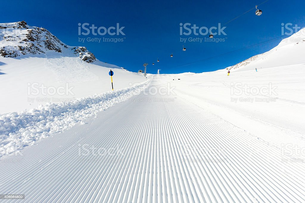 Groomed ski run at ski resort stock photo