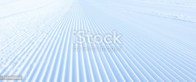 istock groomed snow at ski slope 1074850302