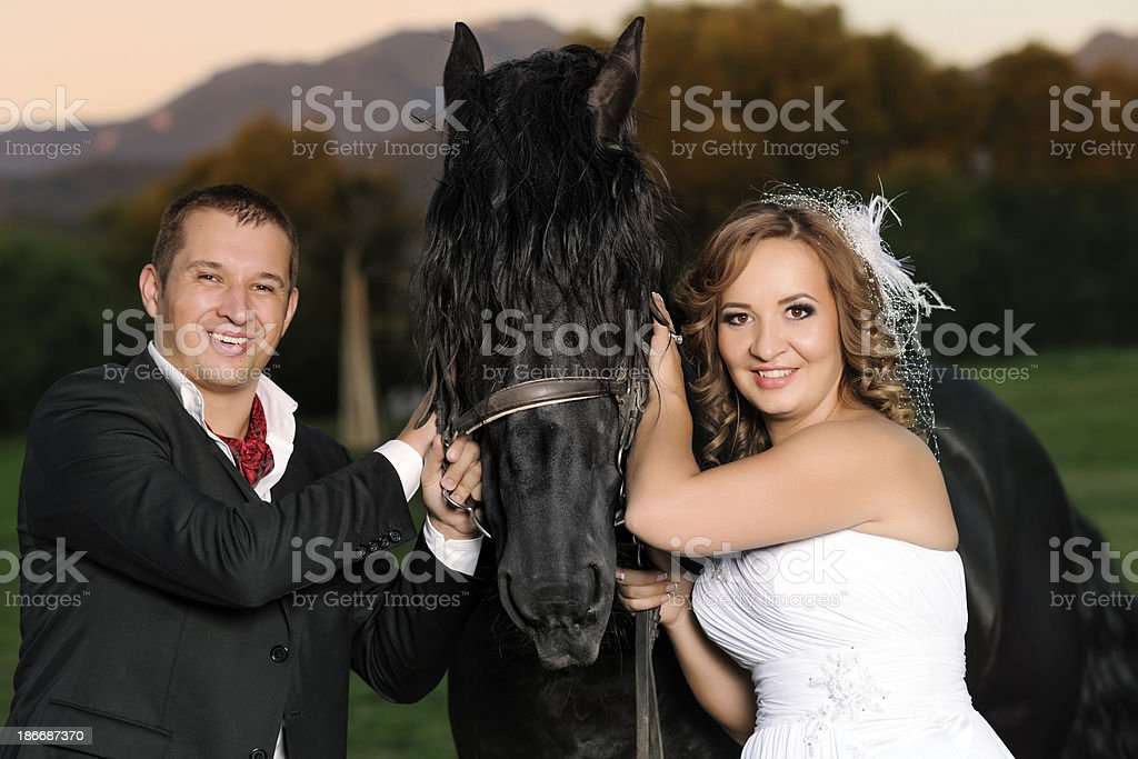grooms and horse: friendship royalty-free stock photo