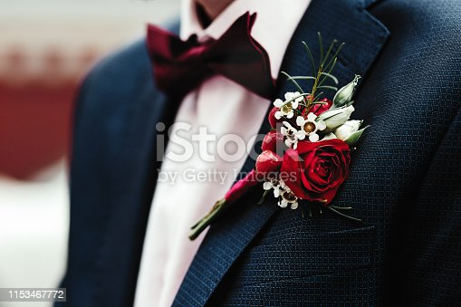Groom's boutonniere on the jacket red red rose