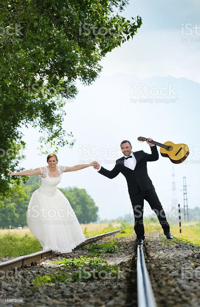 grooms on railway royalty-free stock photo