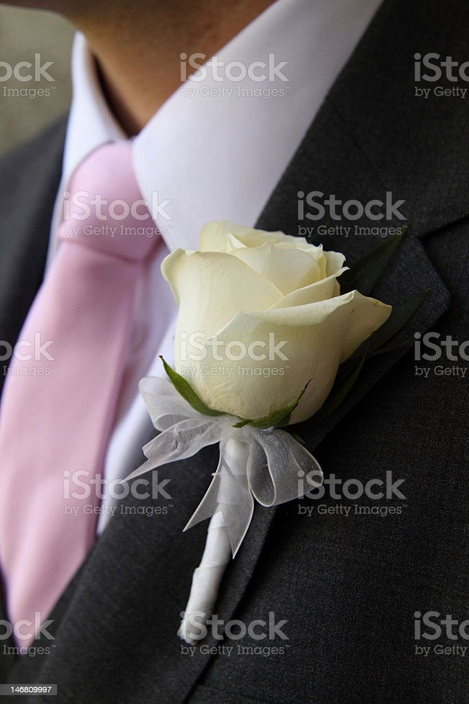 groom's white rose boutonniere royalty-free stock photo