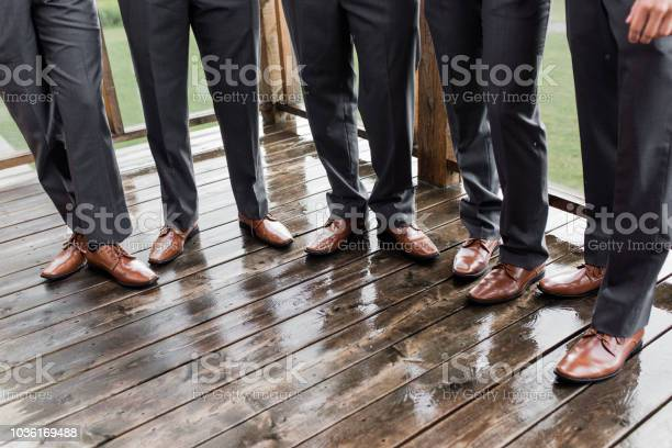 Groomsmen legs and shoes in a row picture id1036169488?b=1&k=6&m=1036169488&s=612x612&h=8qylrfbtvrstjlby b0ybldswani4vt lj6i4mplgeu=