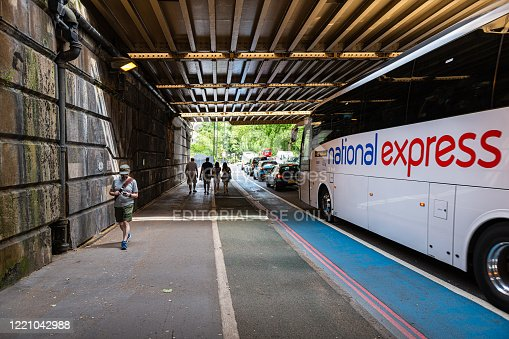 512860403 istock photo Grosvenor road street with underpass and National Express bus in traffic and people 1221042988