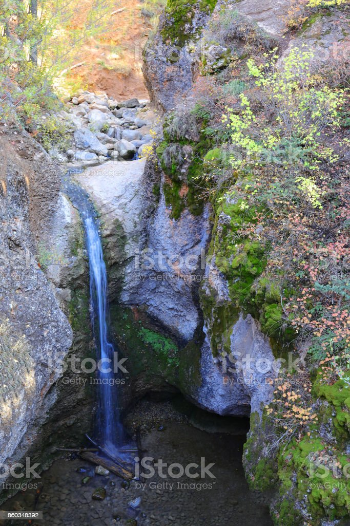 Grotto Falls in Payson Canyon shows its fall colors. stock photo