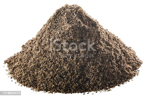Pile of ground black pepper or peppercorns, isolated