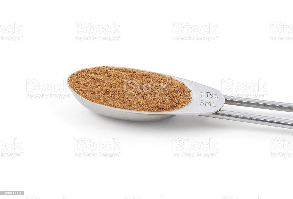 Ground cinnamon measured in a metal teaspoon royalty-free stock photo