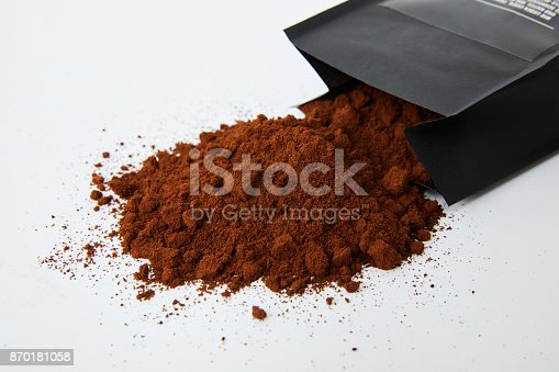 867484488 istock photo Ground coffee beans spilling out from the package 870181058