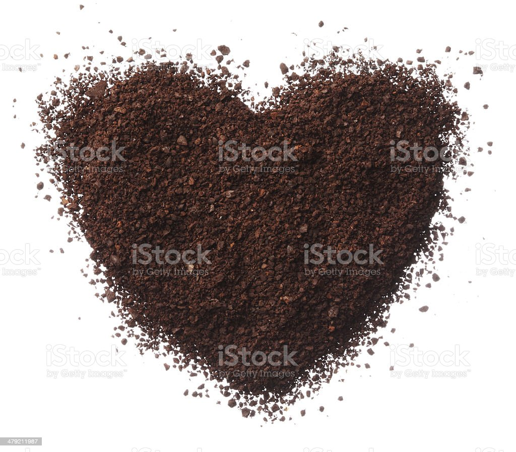 Ground coffee heart isolated on white background close up stock photo