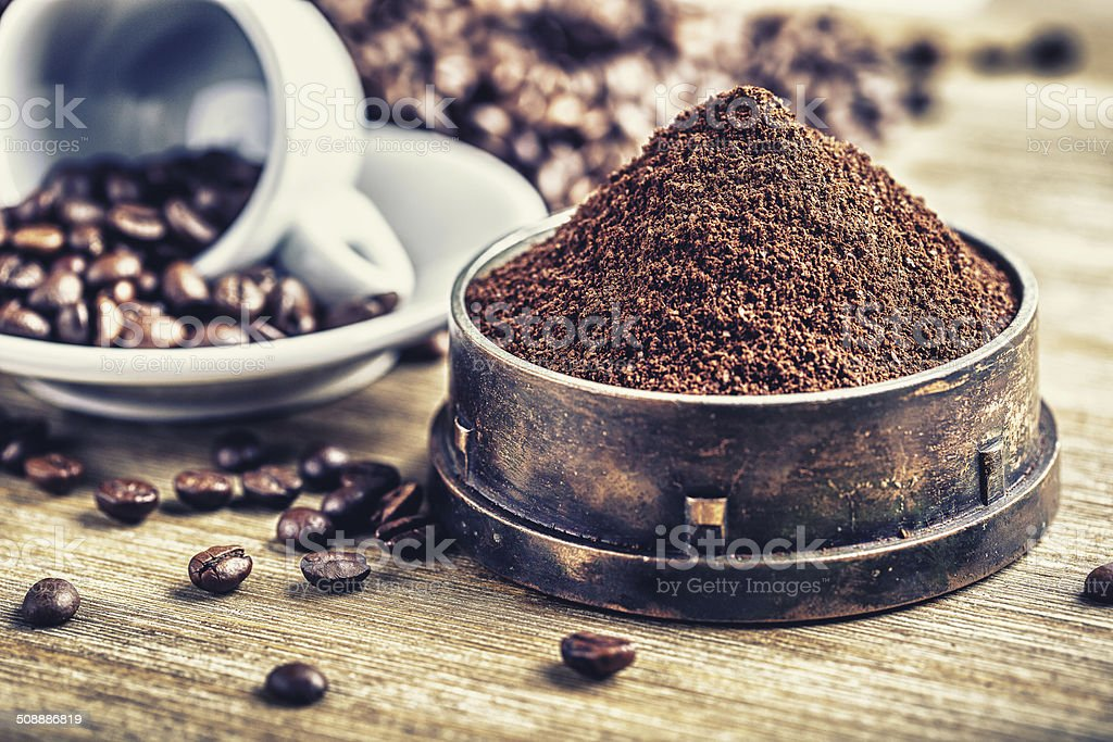 Ground coffee in an old grinder. stock photo