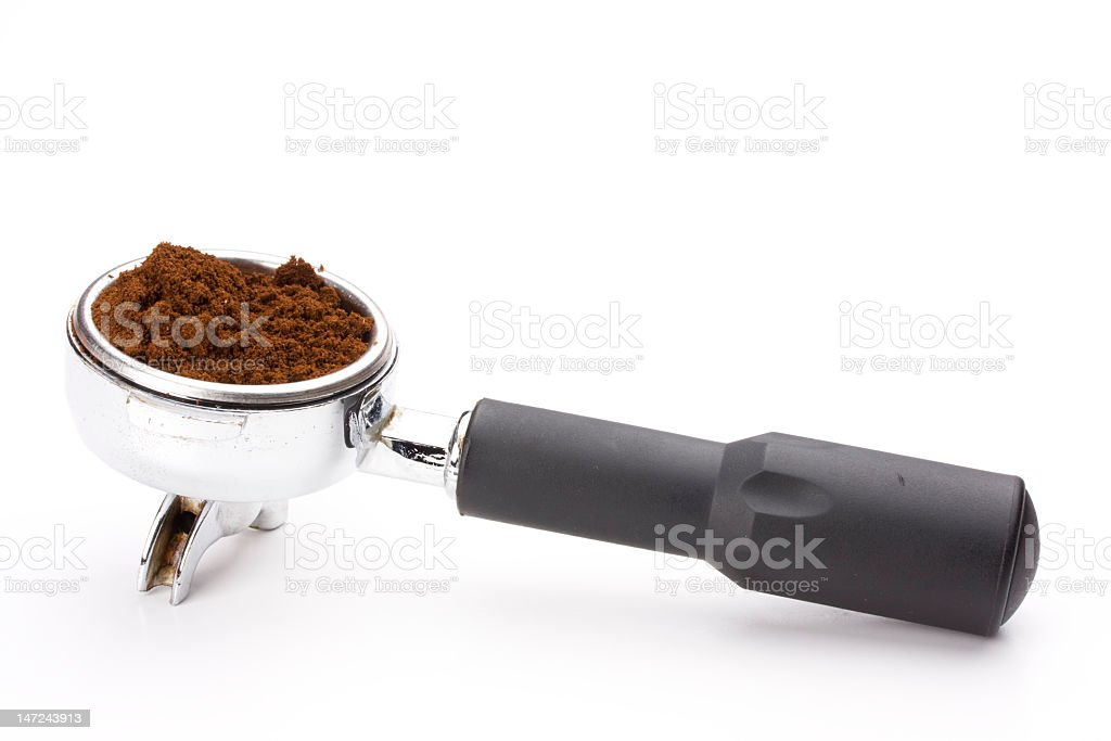 Ground coffee in dispenser against white background royalty-free stock photo