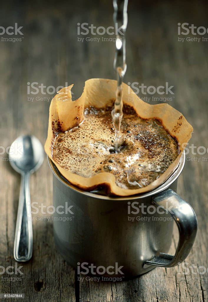 Ground coffee in filter holder isolated stock photo