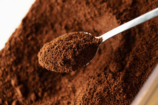 Ground coffee in spoon Ground coffee in spoon, natural coffee background, macro caffeine stock pictures, royalty-free photos & images