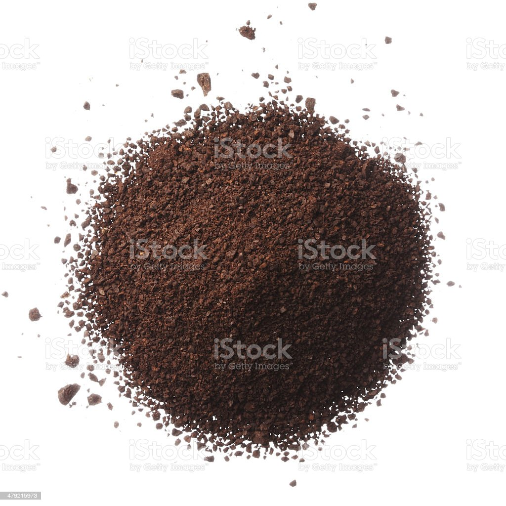Ground coffee pile isolated on white background overhead view stock photo