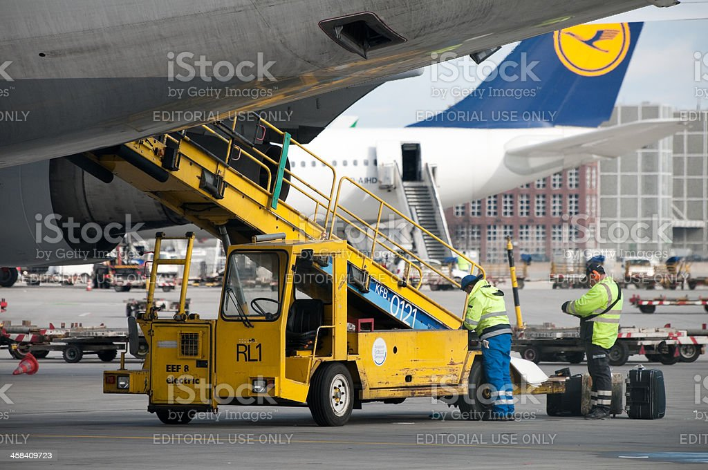 Ground crew delivering luggage at Frankfurt Airport stock photo