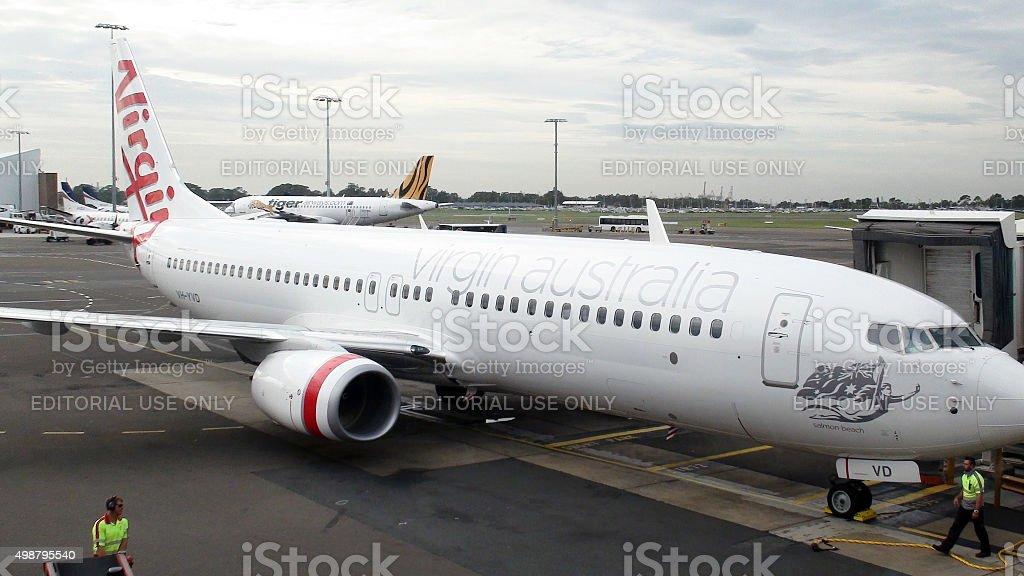 Ground Crew Helping Virgin Australia Pilot At Loading Gate.Sydney.Airport.Australia stock photo