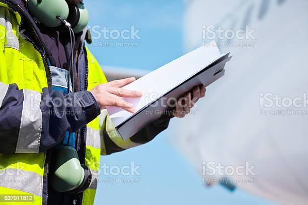 Ground Crew In Front Of Airplane Stock Photo - Download Image Now