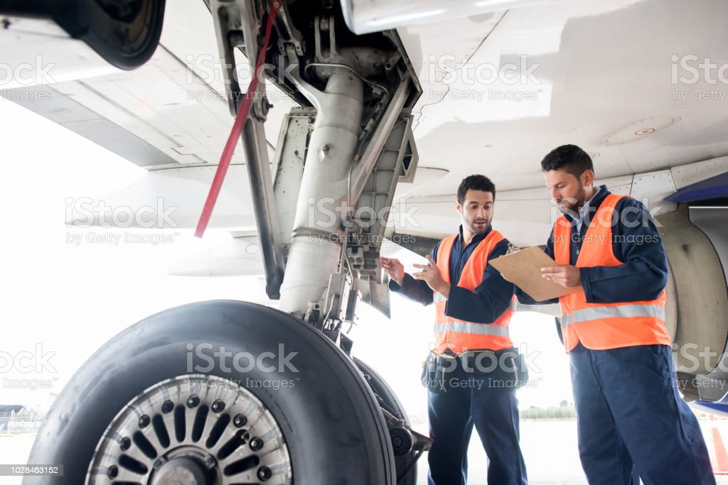 Ground crew working at the airport stock photo