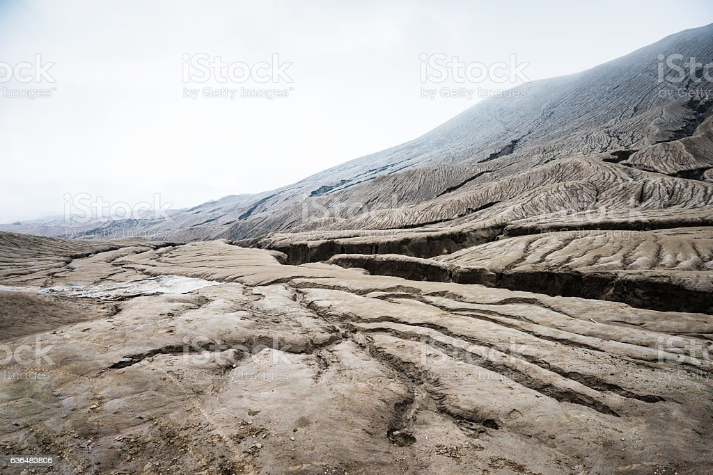 ground fracturing the sand sea of Mount Bromo stock photo
