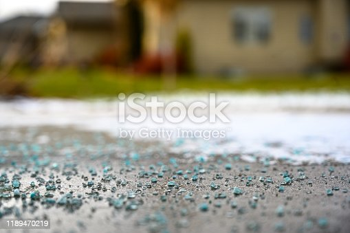 close focused low angle view of salt, ice, and snow