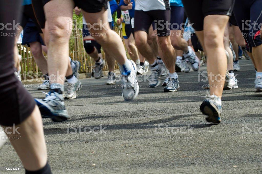 Ground level photo of runners legs stock photo