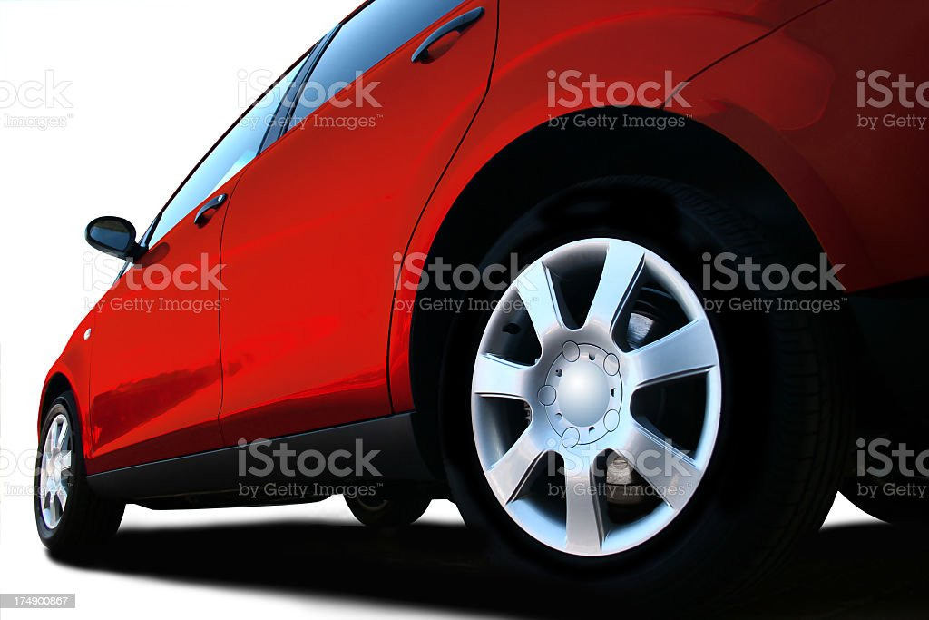 A ground level shot of the back wheel of a car royalty-free stock photo