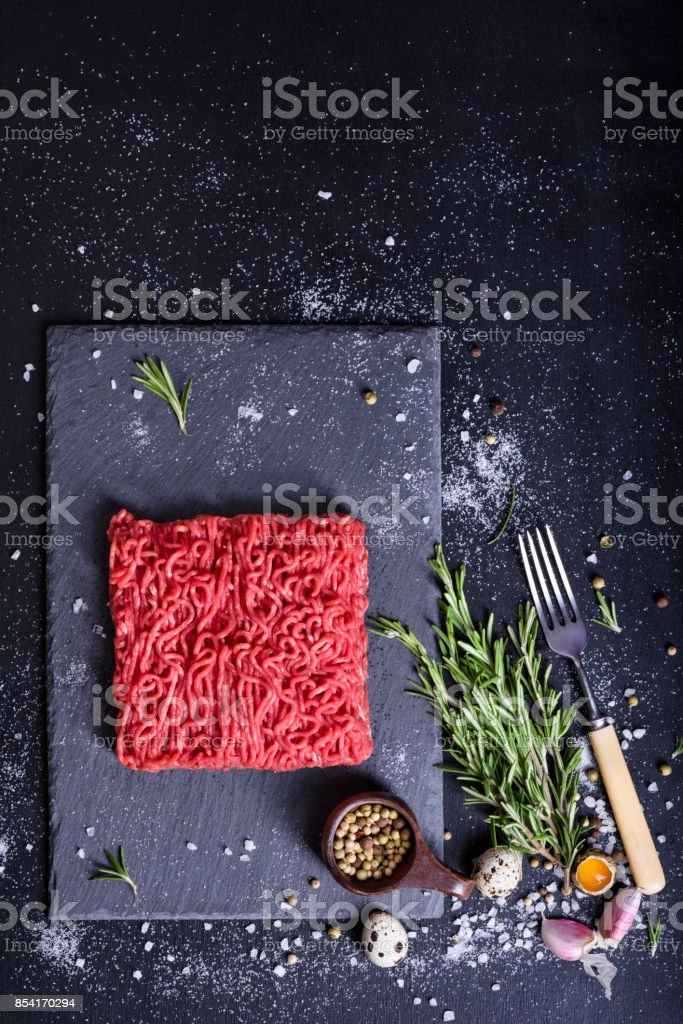 Ground meat, burger patty preparation, seasoning, spices and herbs. stock photo