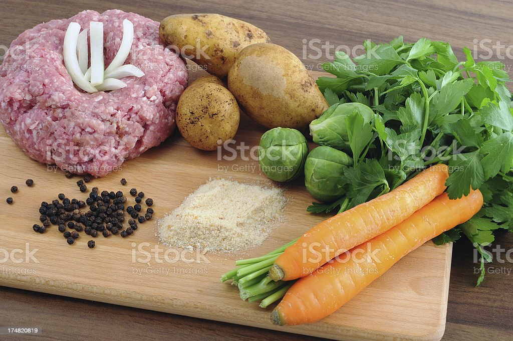 Ground meat in form of Hedgehog breadcrumbs onions pepper parsley royalty-free stock photo