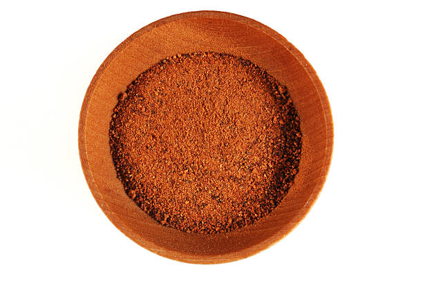 Ground Nutmeg in a bowl stock photo
