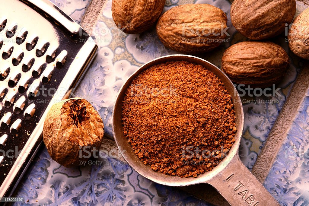Ground nutmeg in measuring spoon stock photo