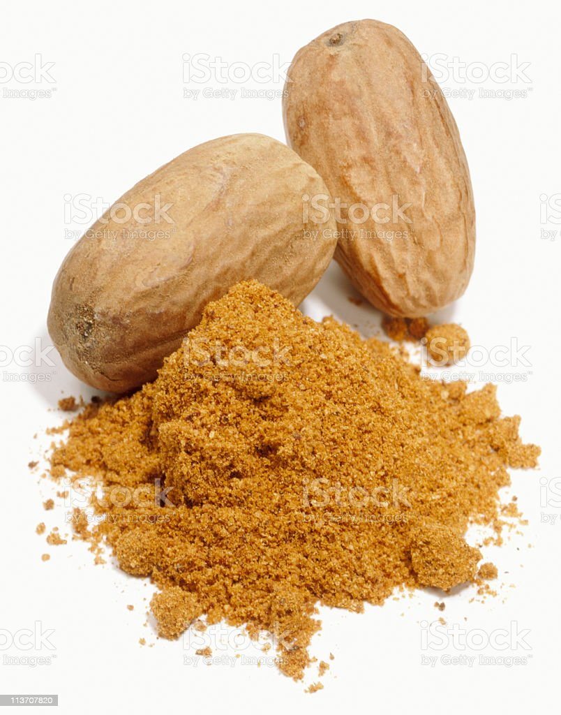 Ground nutmeg on a white background stock photo