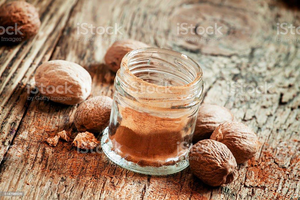 Ground or whole nutmeg stock photo