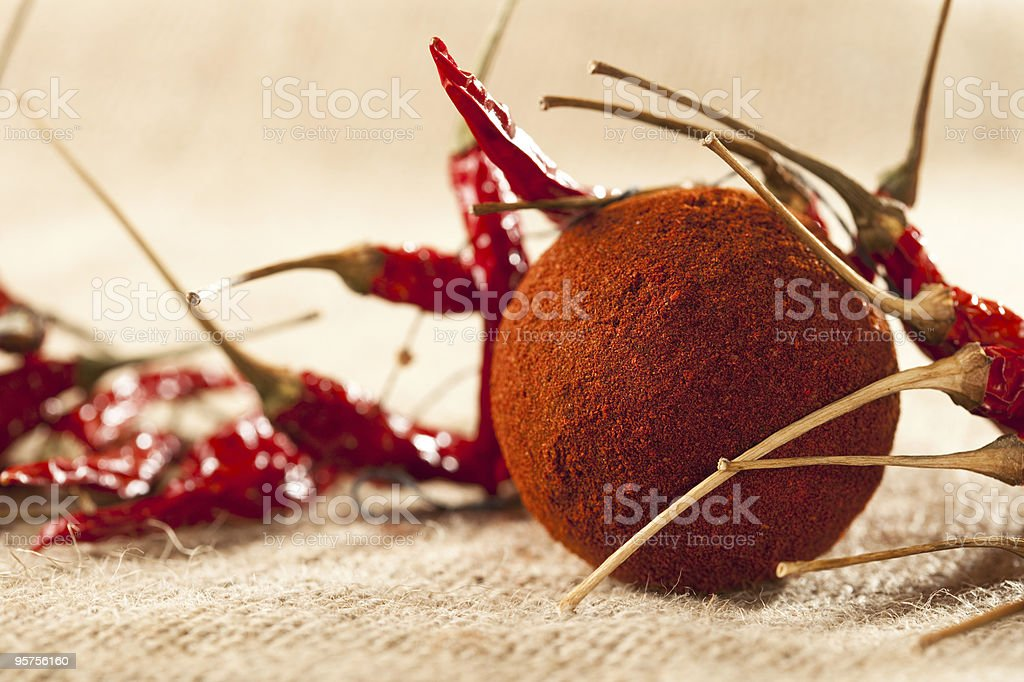 ground paprika in round shape with dried chillies, royalty-free stock photo