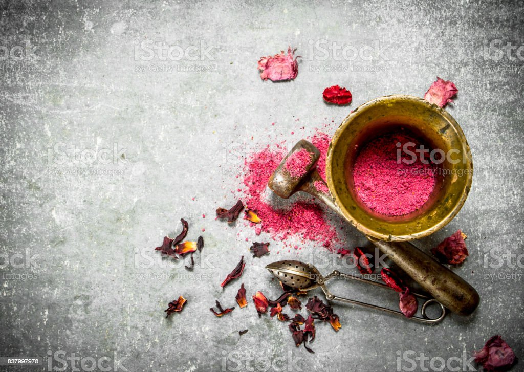 Ground pomegranate tea in a mortar. stock photo