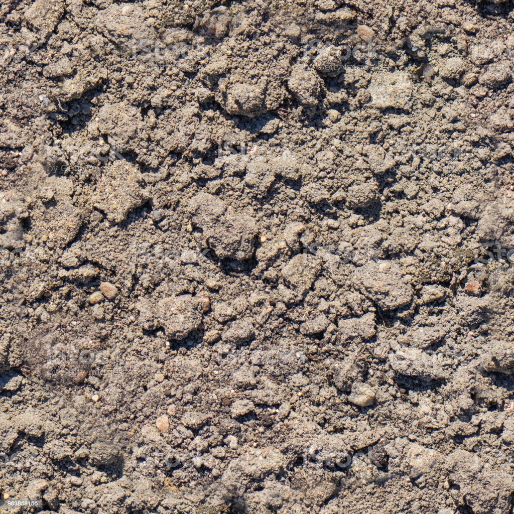 Ground seamless textured surface background under bright sunlight closeup texture - Royalty-free Backgrounds Stock Photo