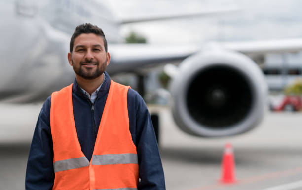 Ground technician working at the airport stock photo