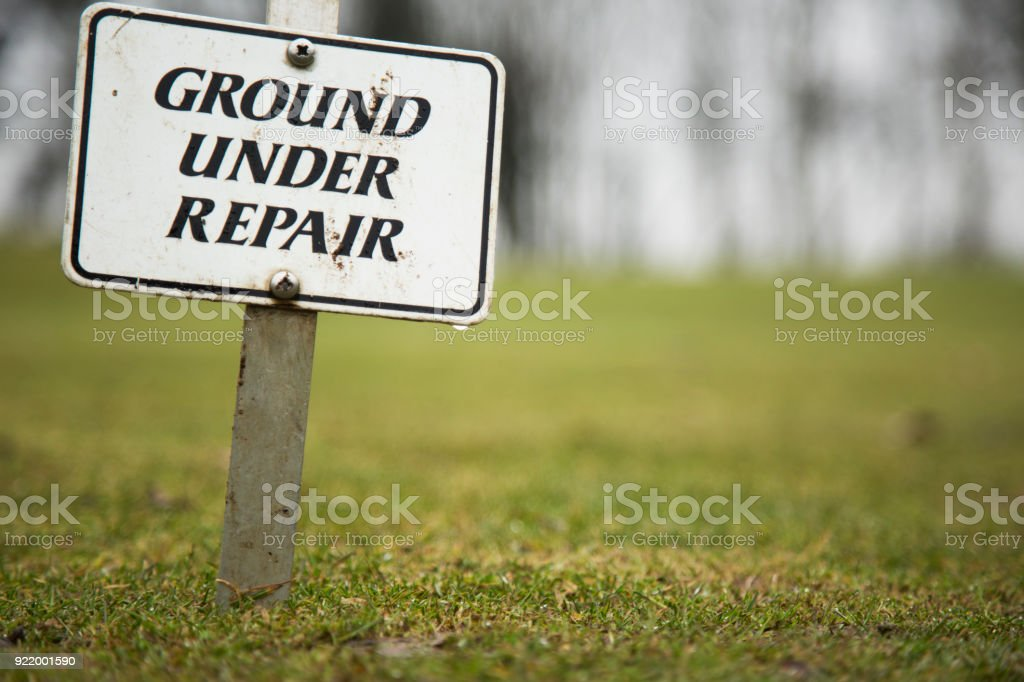 Ground under repair sign stock photo
