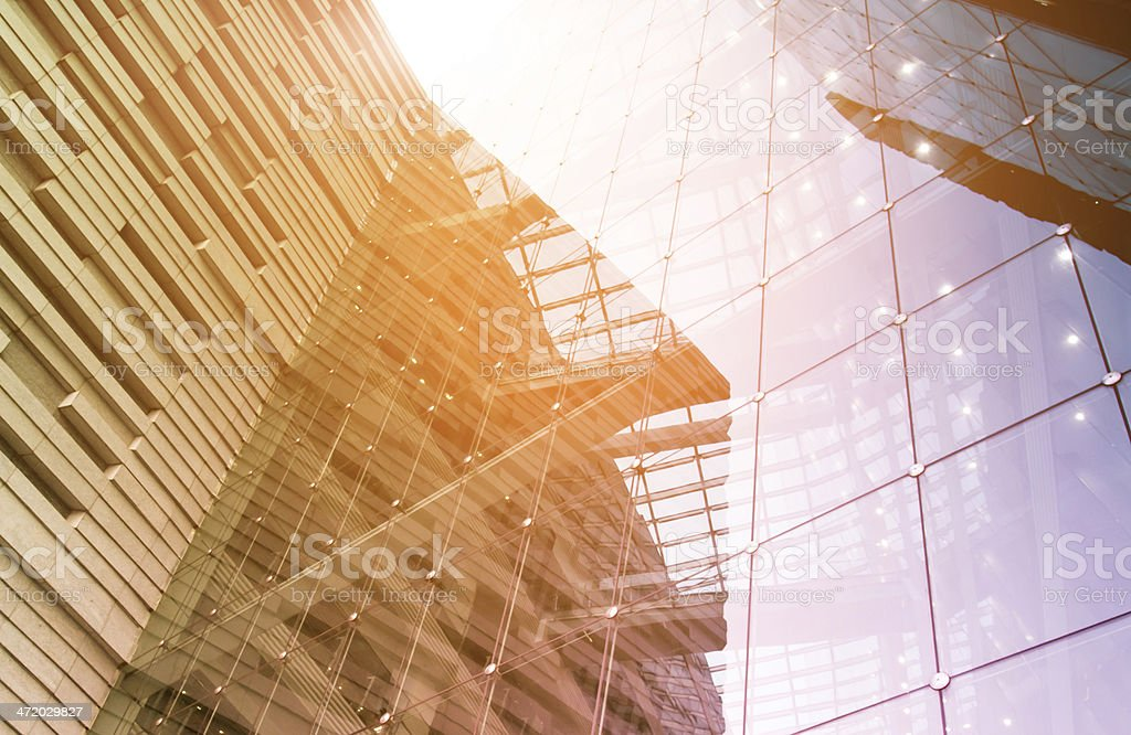 A ground view of a modern glass office building stock photo