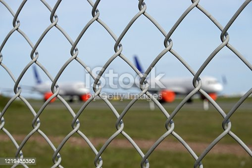 Multiple grounded airplanes parked on the runway. Worldwide the airline industry has been taking a hard financially hit due to the Covid - 19, Corona Virus Pandemic.