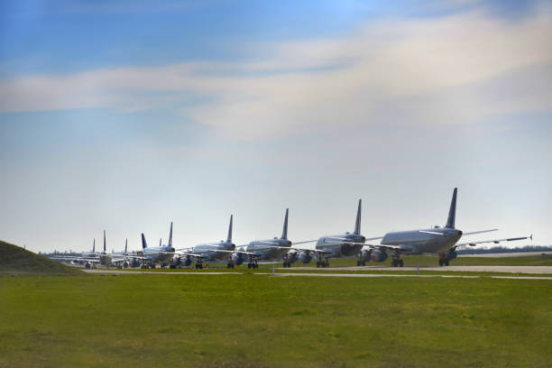 Grounded Airplane, Covid - 19 Corona Pandemic Multiple grounded airplanes parked on the runway. Worldwide the airline industry has been taking a hard financially hit due to the Covid - 19, Corona Virus Pandemic. aground stock pictures, royalty-free photos & images