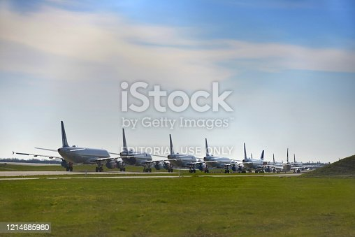 Multiple grounded SAS Scandinavian Airlines airplanes parked on the runway due to the Corona Virus / Covid -19 crisis in Copenhagen, Denmark. Worldwide the airline industry has been taking a hard financially hit due to the Corona Virus Pandemic.
