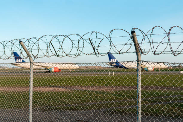 Grounded airplanes at the airport stock photo
