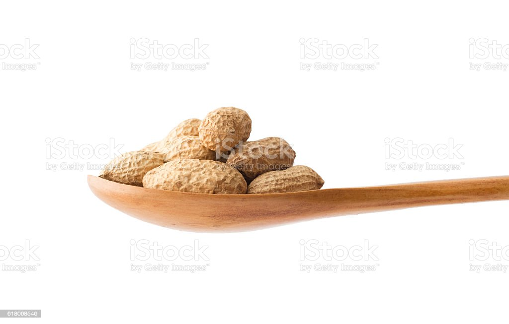 Groundnuts in a wooden spoon stock photo