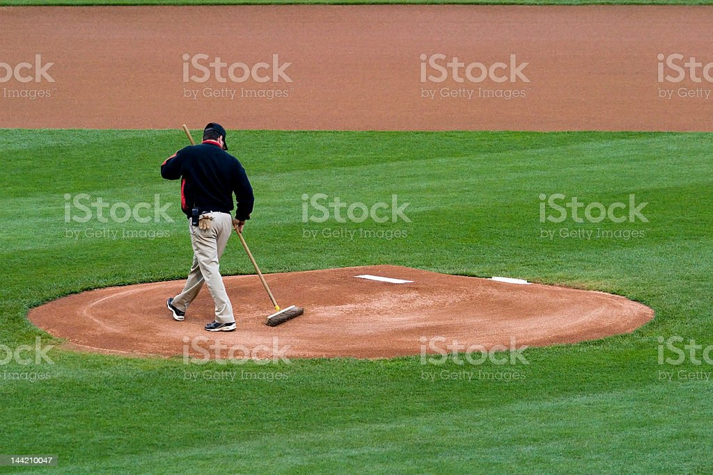 Groundskeeper on Pitching Mound stock photo