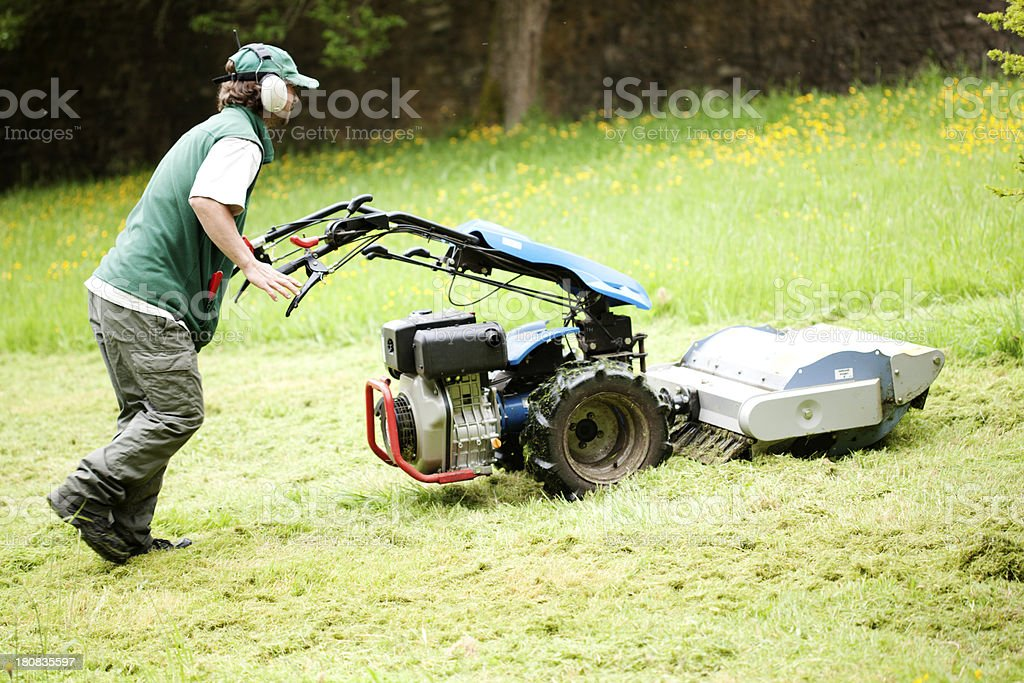 Groundsman mowing stock photo