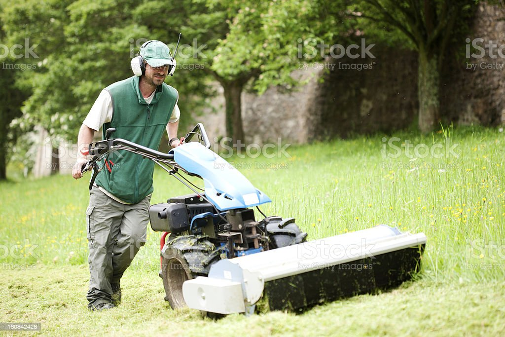 Groundsman with mower stock photo
